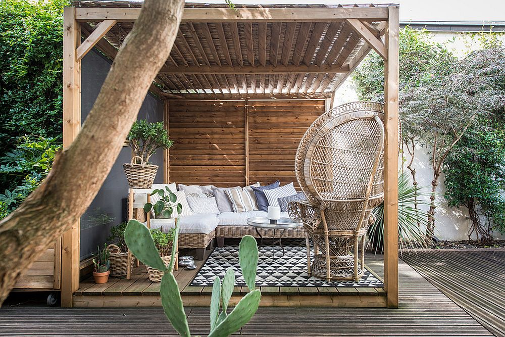 Tropical-style-coupled-with-traditional-motifs-inside-the-covered-deck-of-Paris-home