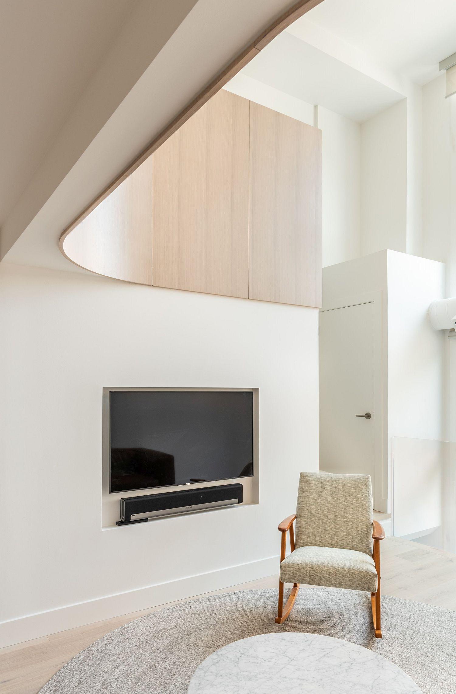 Ultra-minimal white living room of loft inside a church