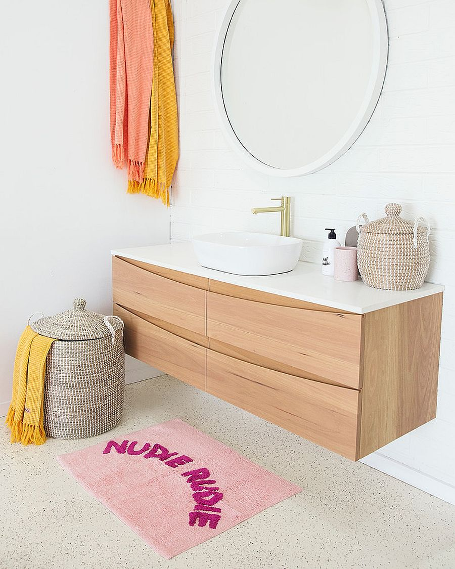 Use simple accents to add color to the neutral bathroom