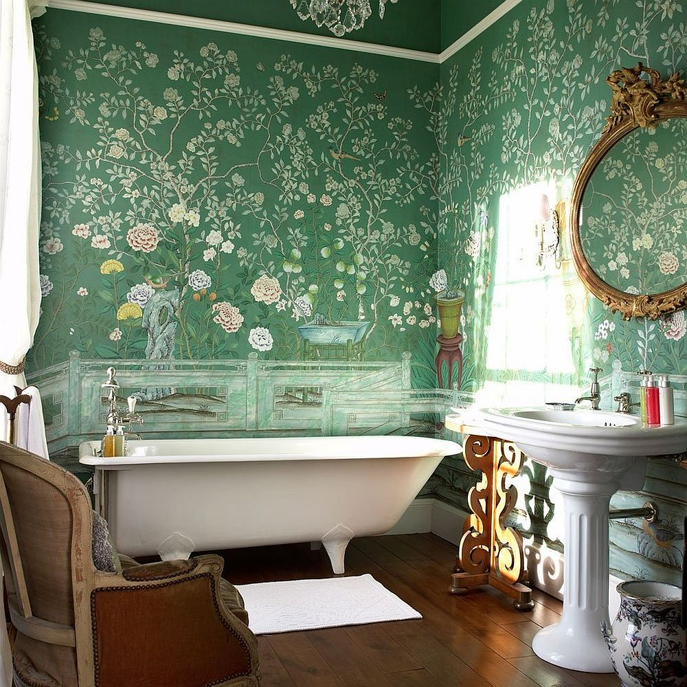 Victorian meets modern inside this dark green and lavish bathroom