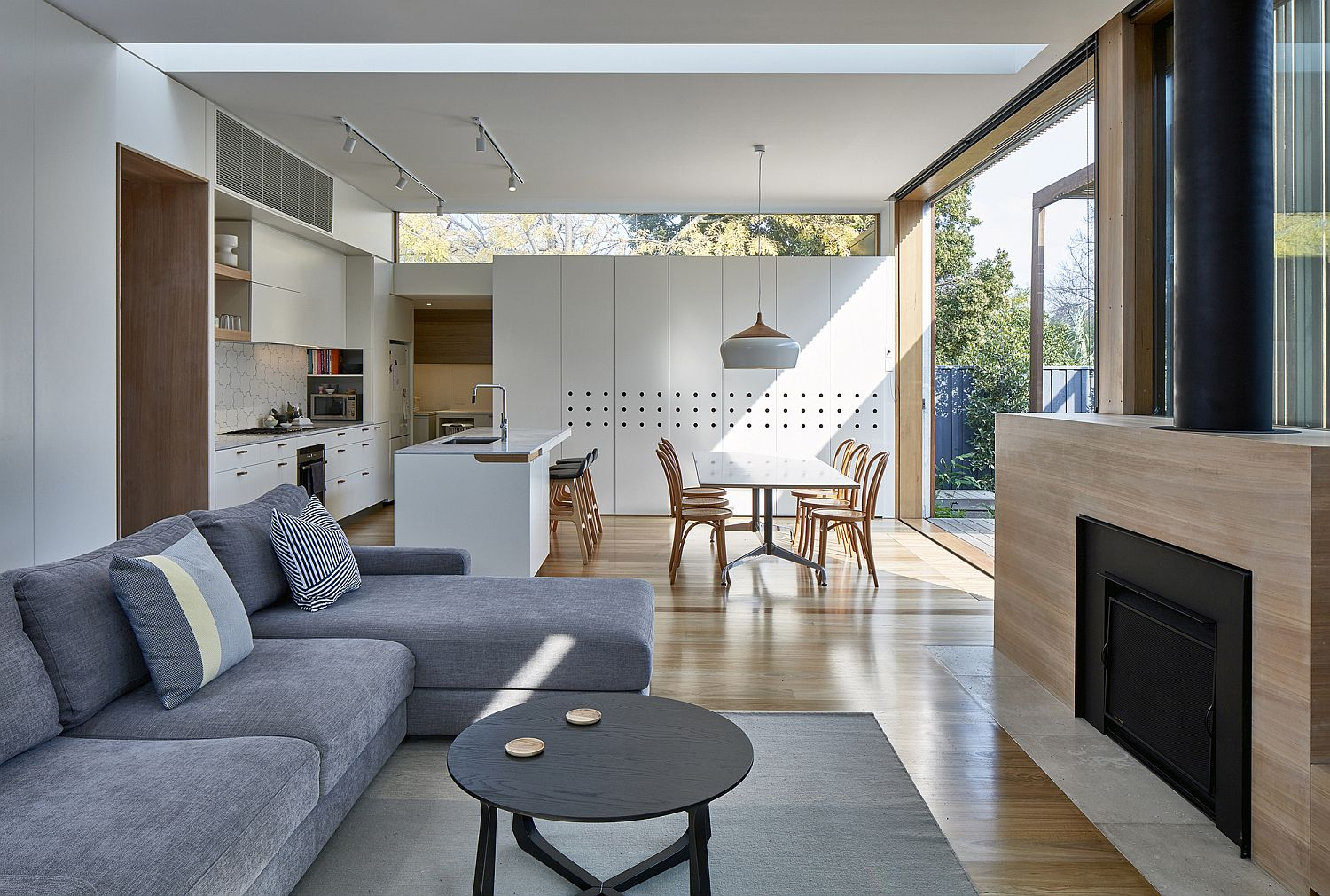 View of the new open plan living area, kitchen and dining inside the Aussie home