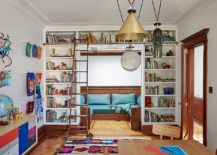 Wall-of-books-along-with-table-for-the-kids-study-room-217x155