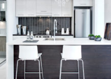 White-and-black-kitchen-with-wood-for-the-central-island-217x155