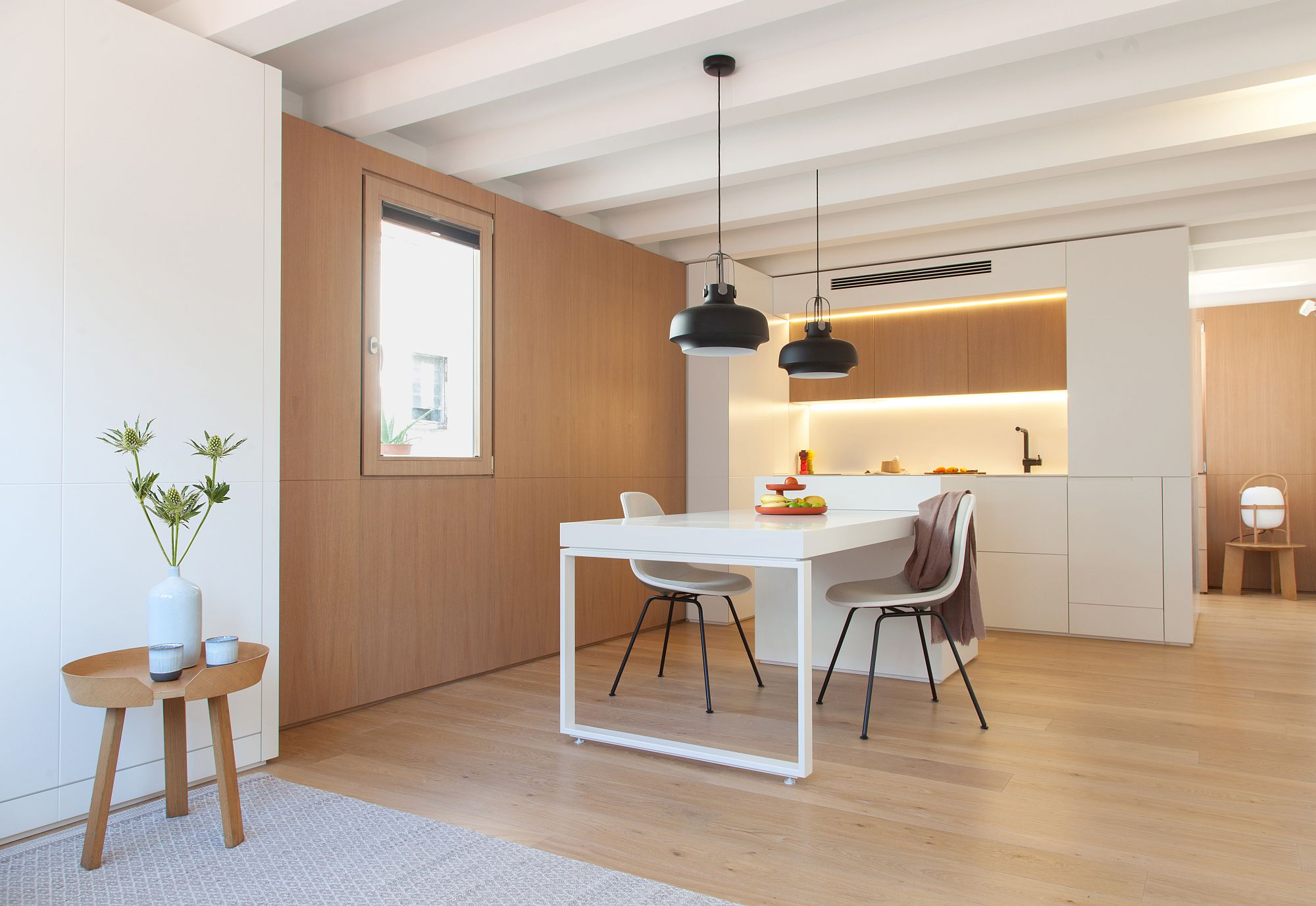 White and wood create a beautiful and space-savvy interior for the tiny Barcelona apartment