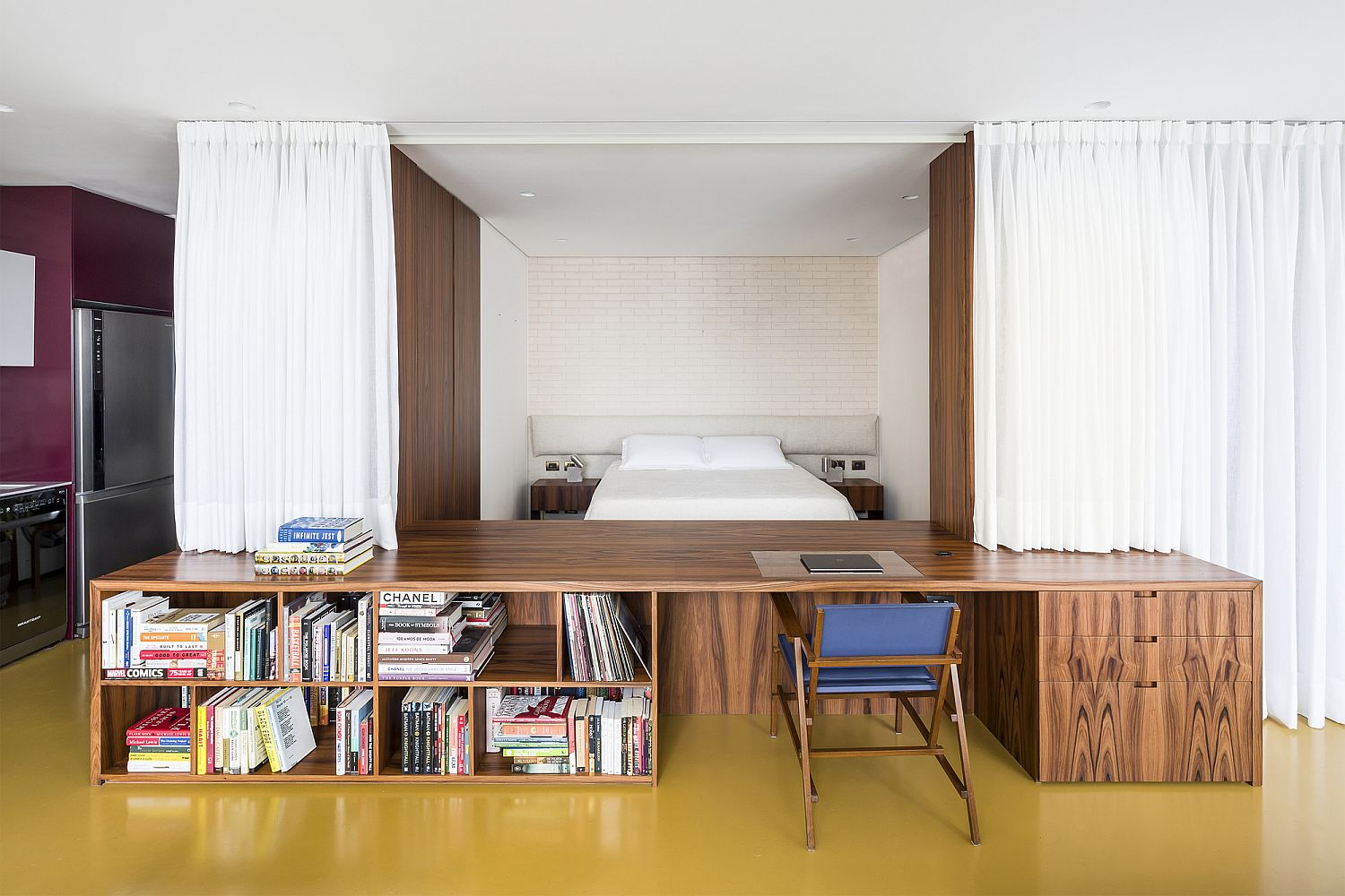 White curtains hide the wooden box entirely when needed