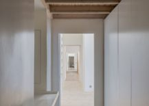 White-hallways-inside-the-apartment-along-with-a-touch-of-woodsy-warmth-217x155