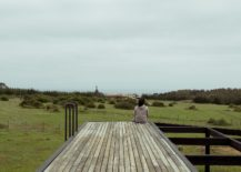 Wooden-deck-with-a-view-of-the-distant-ocean-217x155