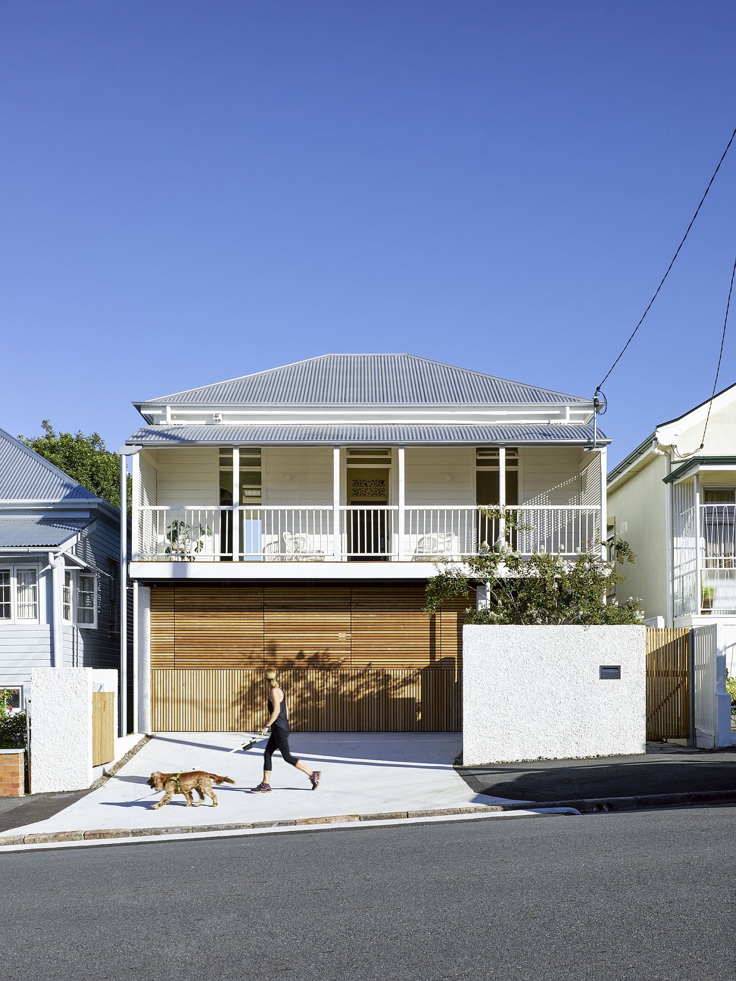 Wooden garage door makes sure that the charm of the street facade is left undisturbed