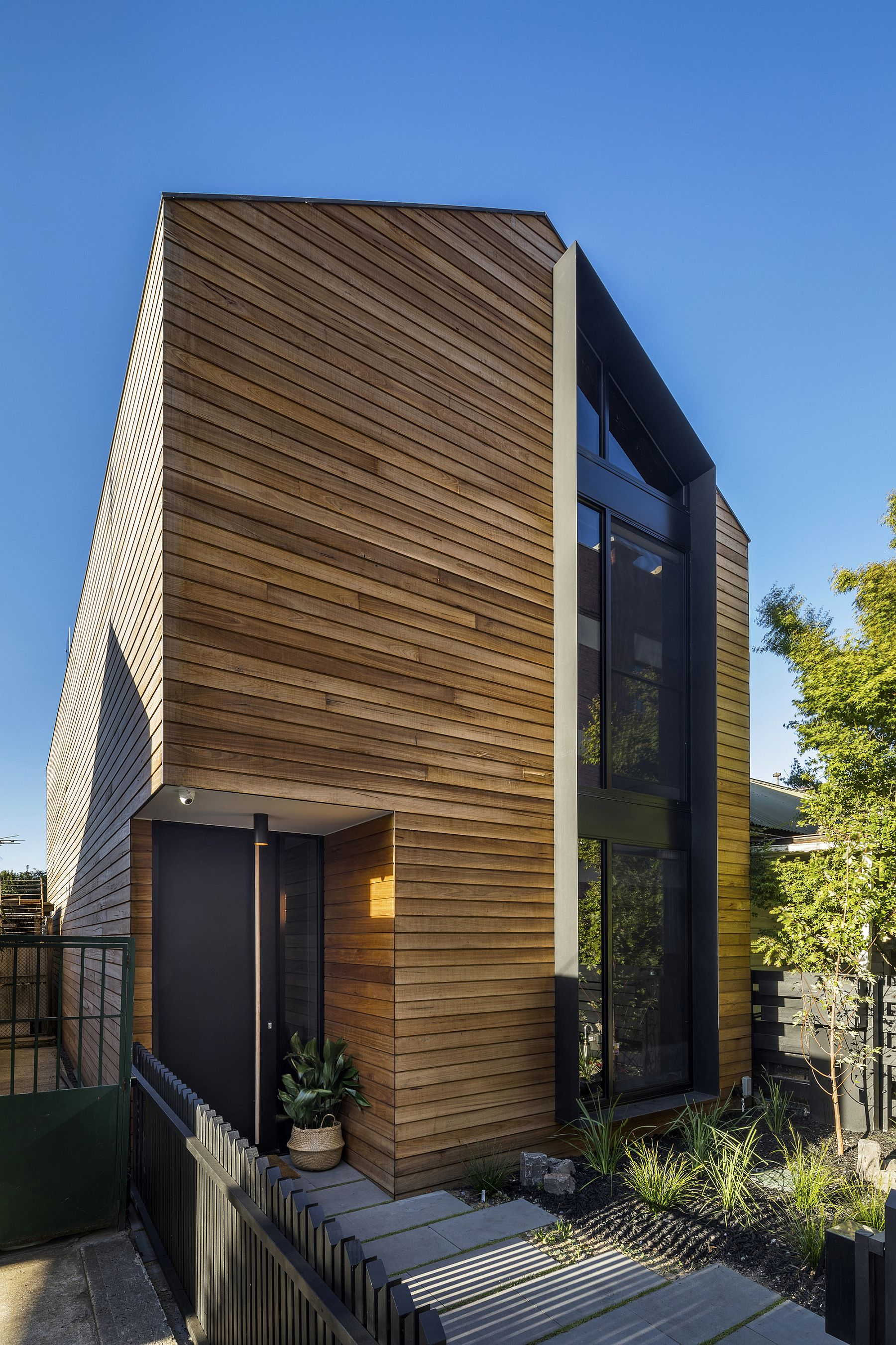 Wooden slats cover the street facade of the T2 Residence