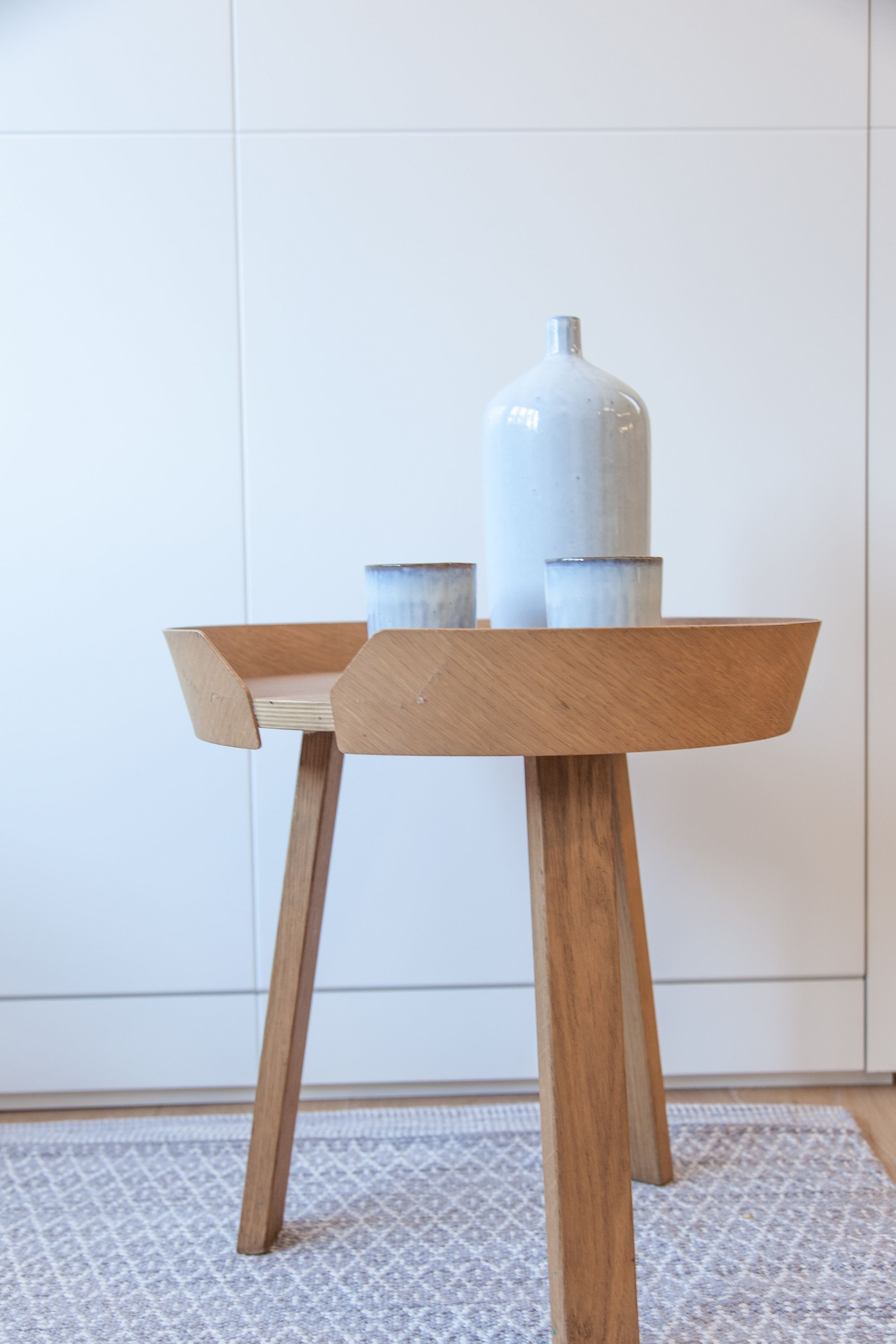 Wooden stools adds to the overall theme of the home