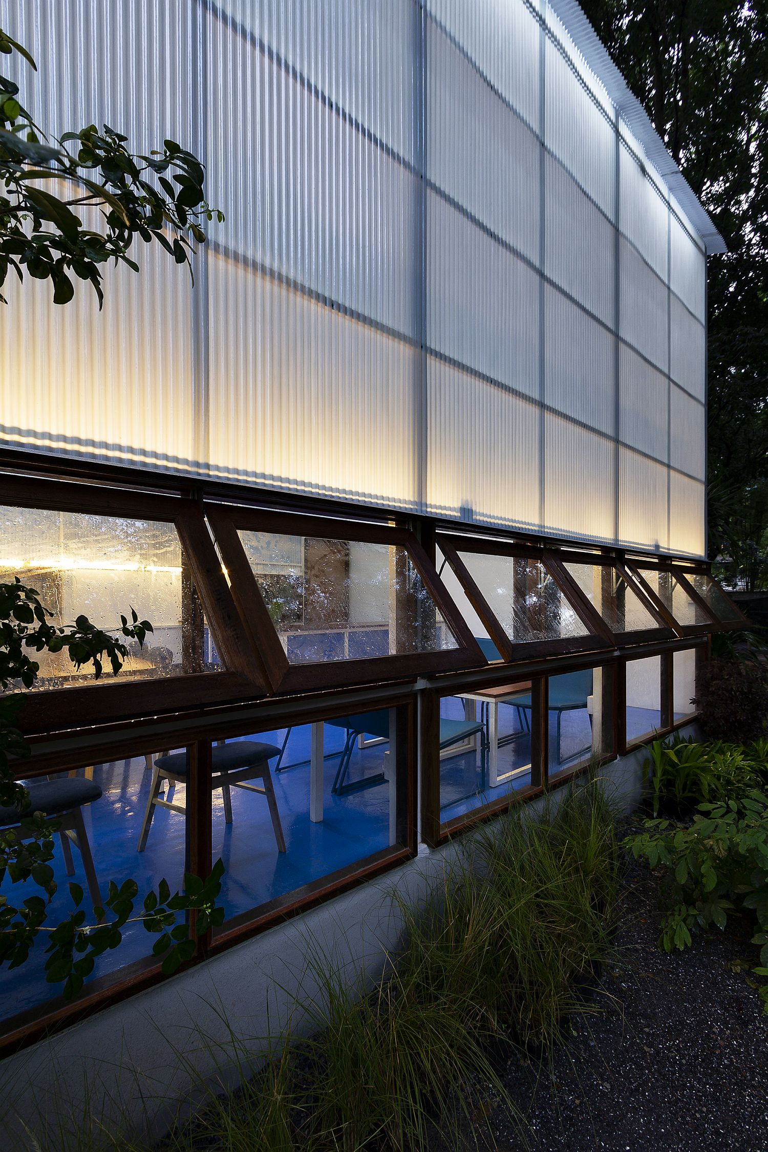 Wooden swing windows offer a peek into the library