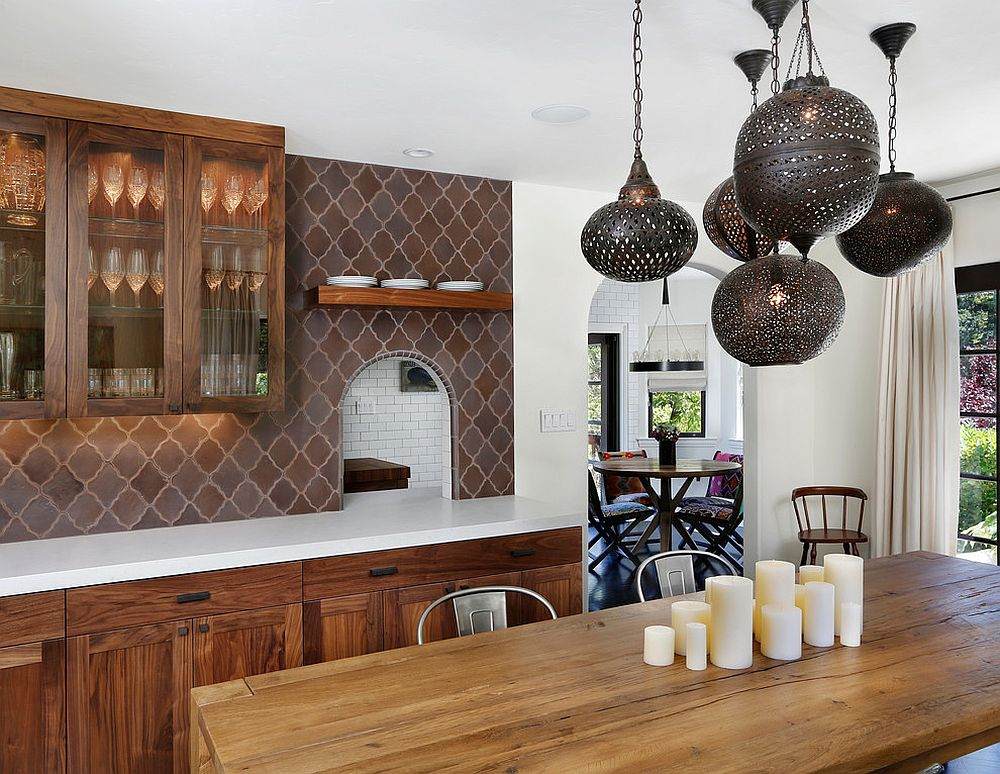 Add Mediterranean charm to the modern dining room with tiles and lighting