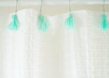 Aqua-tassels-on-a-white-shower-curtain-1-217x155