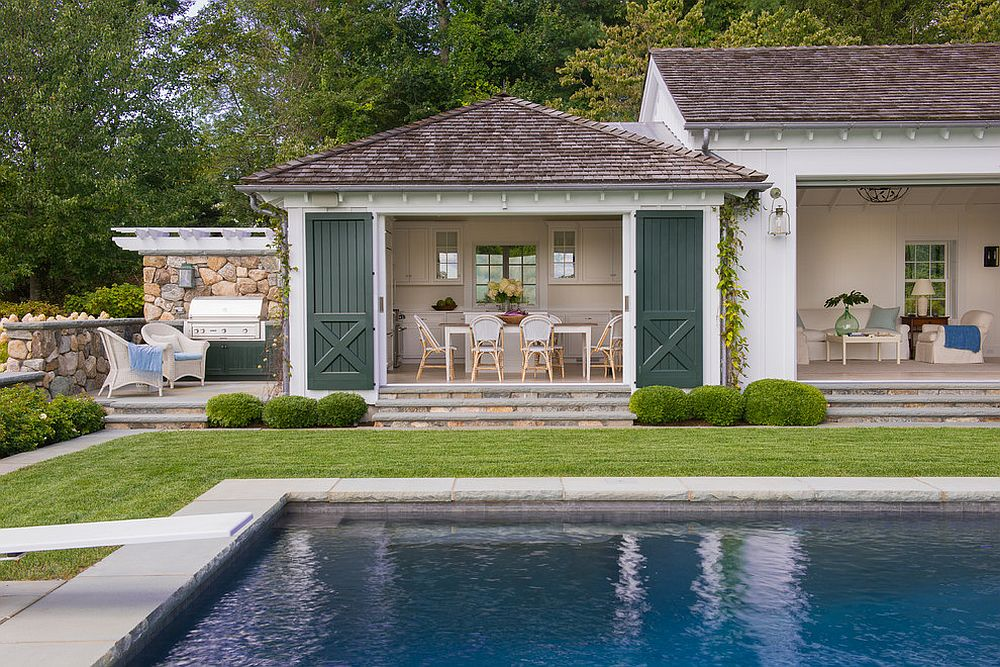 Beach style pool house feels like the perfect place to hold fall festivities