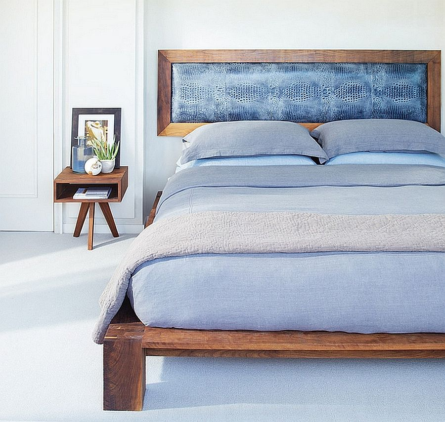 Bedframe and decor can bring wooden element into the white bedroom