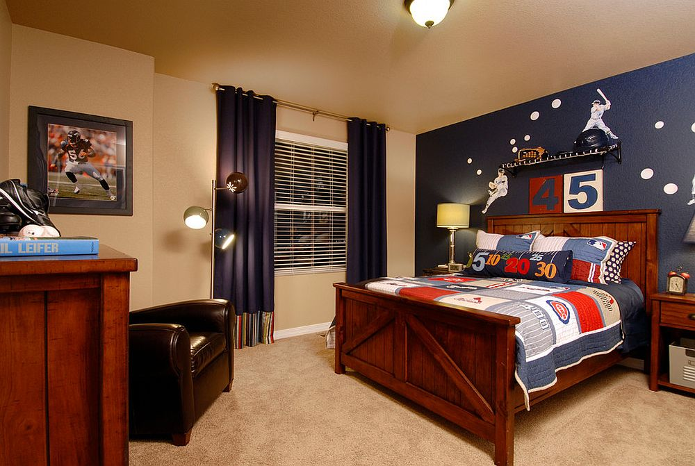 Beige and navy bluee kids'room with sports-themed motifs