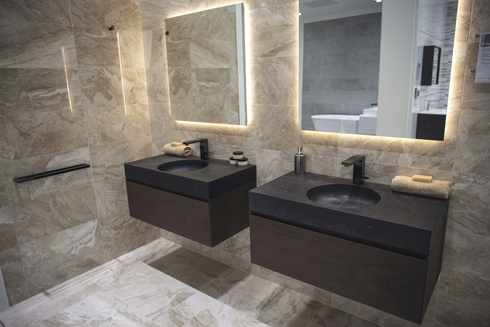 Black stone bathroom vanities with glossy ceramic tiles and recessed lights