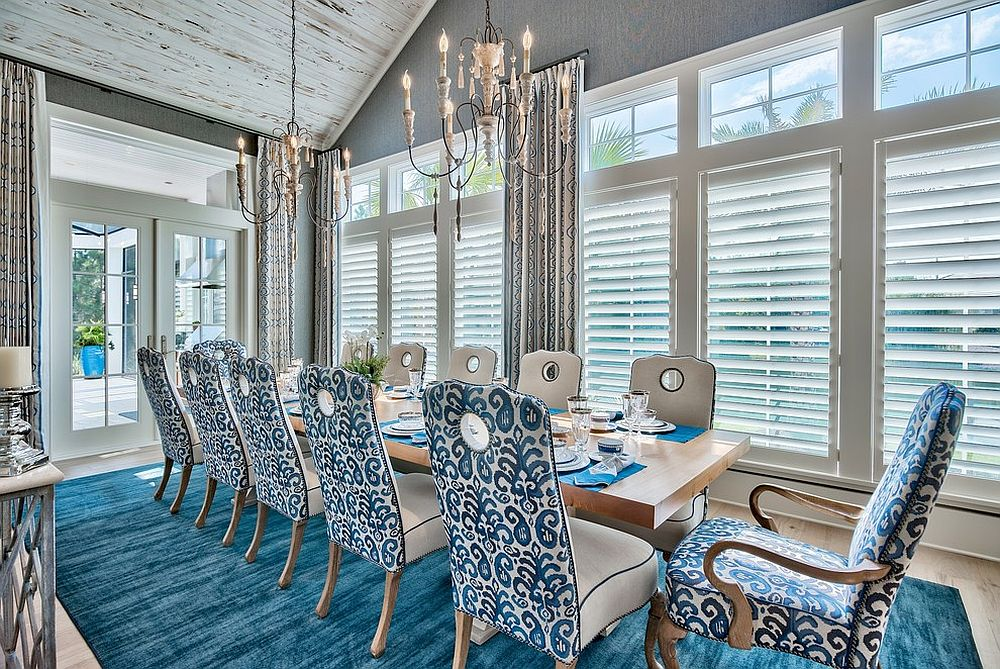 Blue, white and chic beach style dining room with vaulted ceiling
