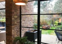Brick-walls-coupled-with-framed-glass-windows-inside-the-house-217x155