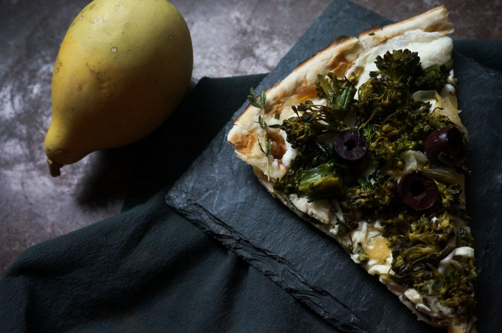 Broccolini pizza with roasted onions