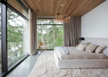Ceiling-and-shutters-add-woodsy-charm-to-this-modern-bedroom-in-white-217x155