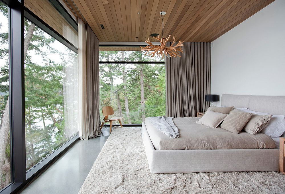 Ceiling and shutters add woodsy charm to this modern bedroom in white
