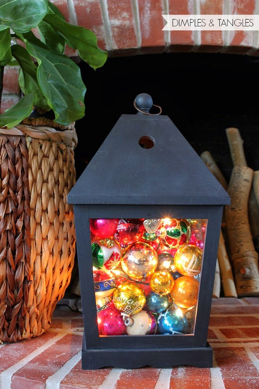 Combining lantern, string lights and Christmas ornaments in a fun and cheerful manner!