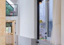 Combining-white-gray-and-wood-inside-the-small-backyard-second-home-217x155