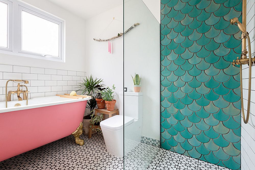 Contemporary bathroom with pink bathtub and an accent wall section with lovely tiles