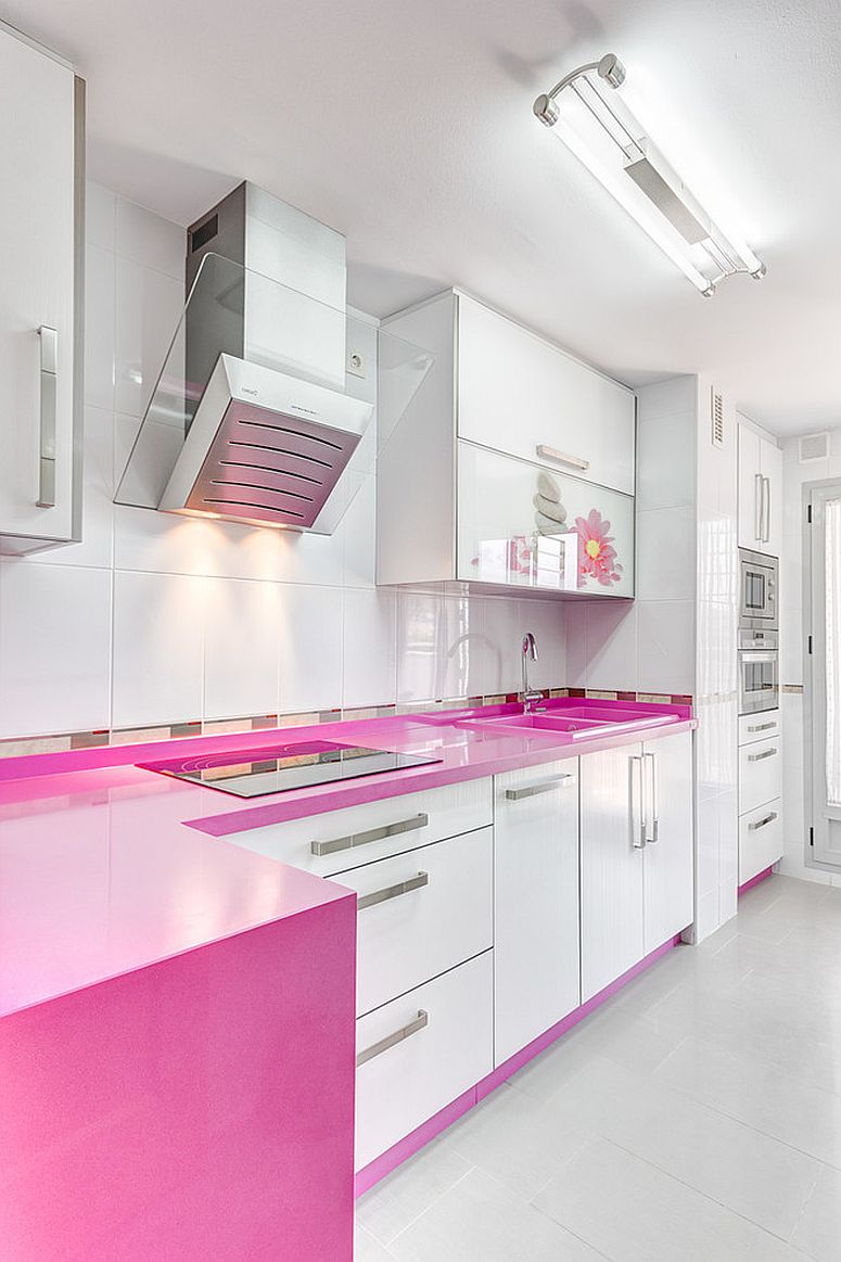 Contemporary kitchen in white with violetish-pink countertops