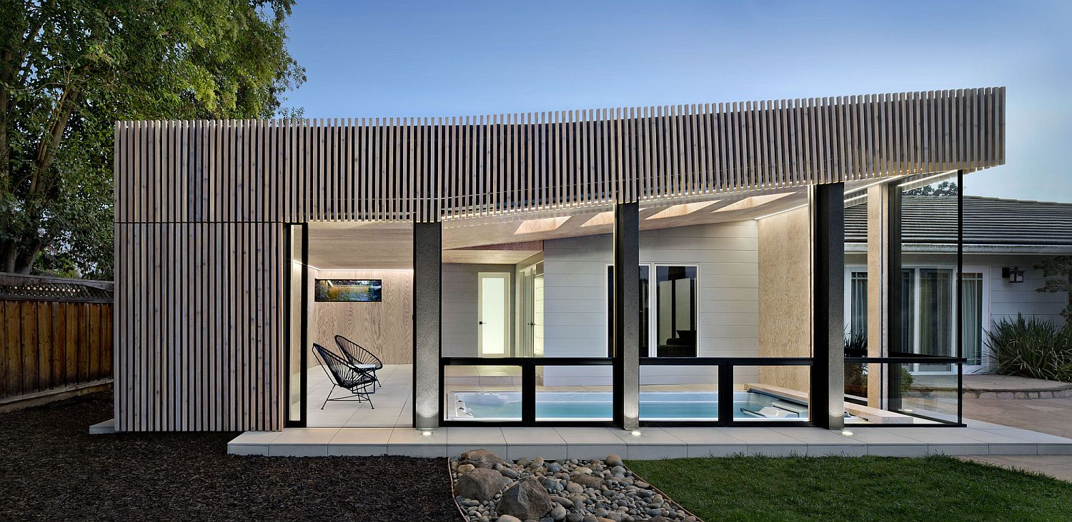 Contemporary-pool-house-for-classic-Los-Altos-home-in-weathered-cedar-leaves-the-original-home-untouched