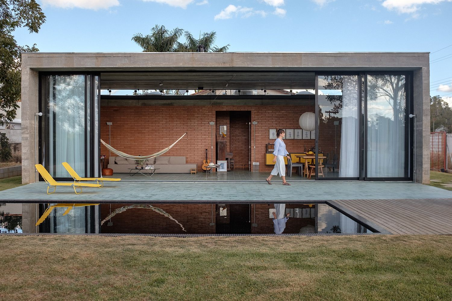 Contemporary pool perfectly reflects that interior of the house