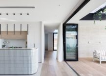 Curved-kitchen-island-design-complements-that-of-the-wall-outside-217x155