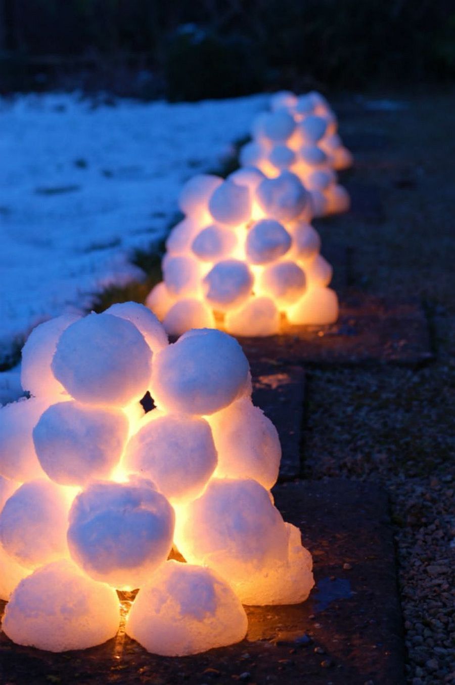 DIY snow lanterns add to the snow-cladd landscape outside on Christmas Eve!