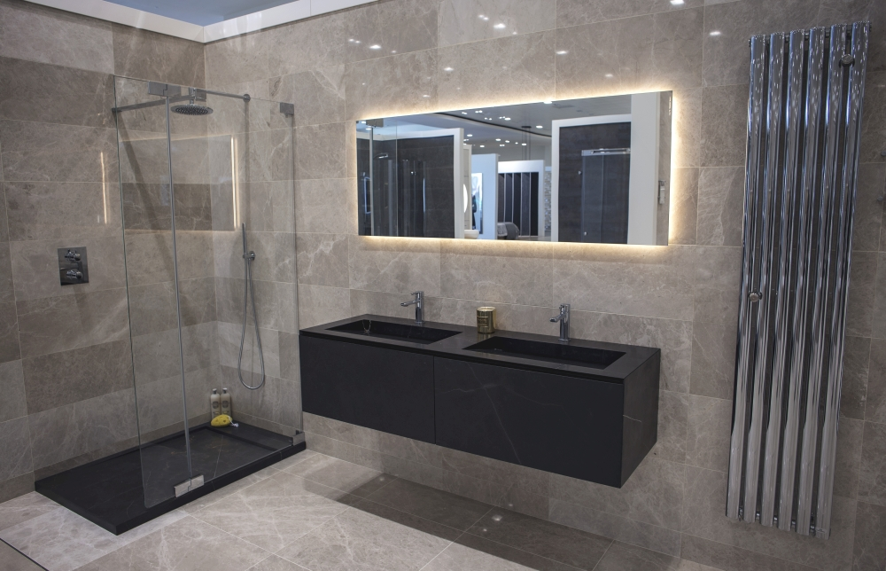 Dark stone vanities in modern glossy bathroom design