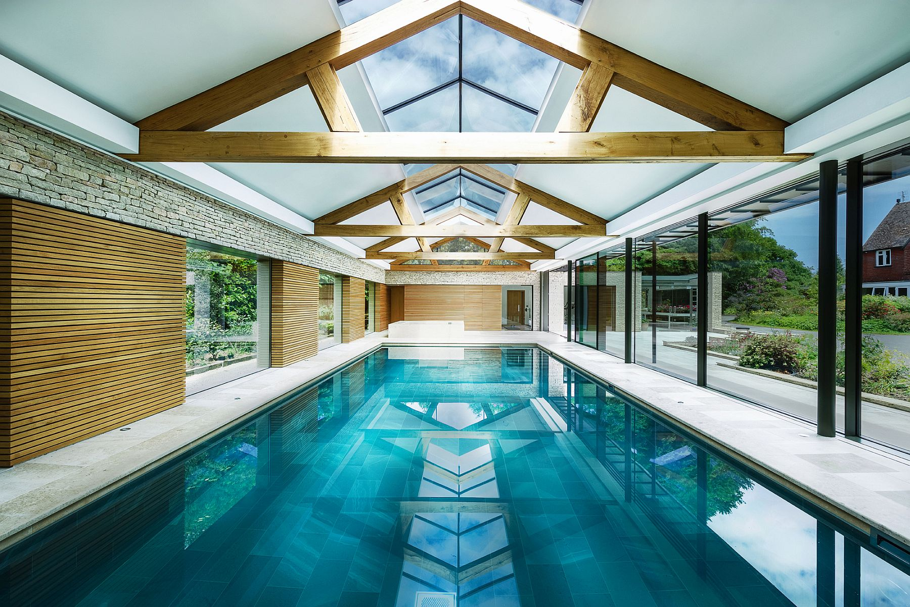 Expansive pool house in UK with skylights is a showstopper!