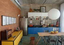 Exposed-red-brick-and-concrete-shape-a-lovely-living-area-217x155