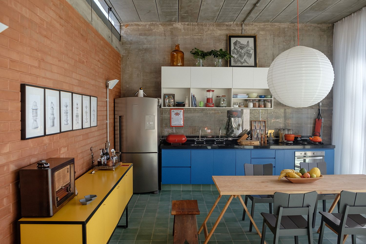Exposed red brick and concrete shape a lovely living area