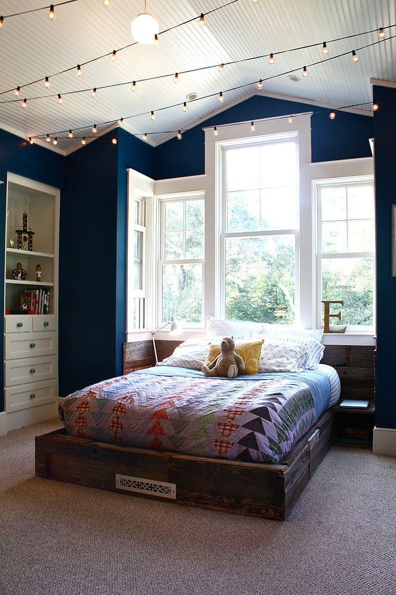 Fun kids' room in navy blue with string lighting
