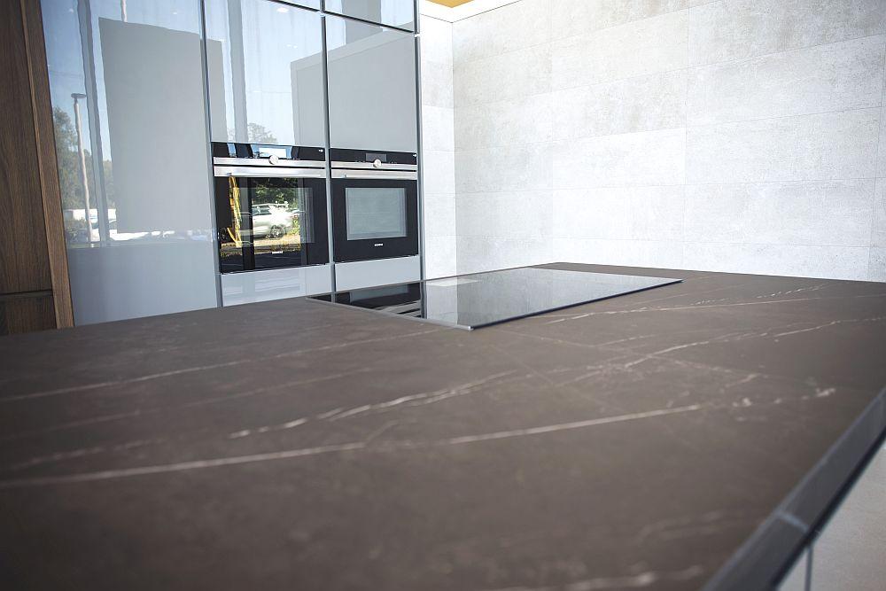 Glossy light grey kitchen with beautiful kitchen island