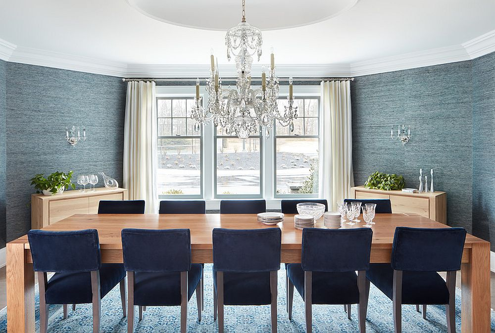 Grand beach style dining room with grasscloth wallpaper that adds texture to the setting