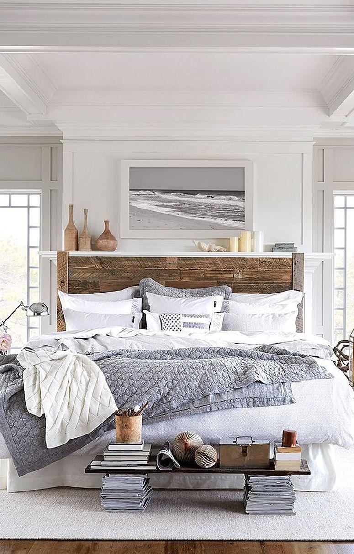 Headboard brings wood to this modern beach style bedroom in white