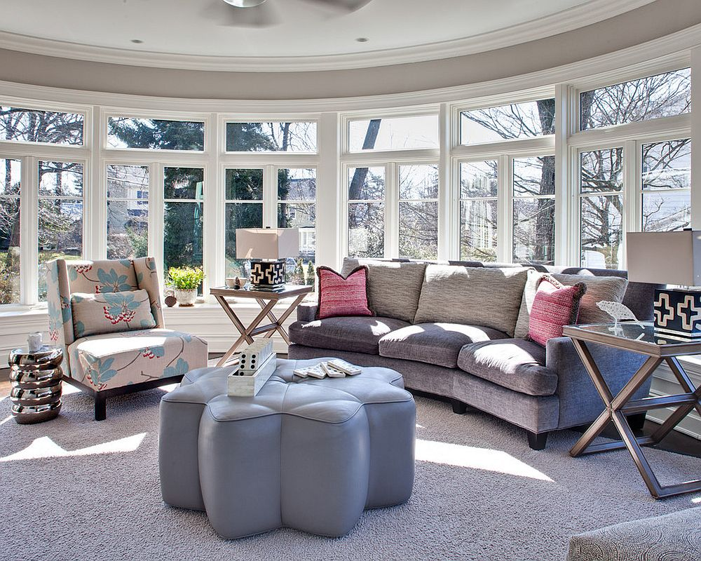 Light-filled New York living room with gray couch and coffee table that is unique