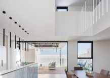 Light-filled-dining-area-and-kitchen-of-the-Sydney-home-in-white-217x155