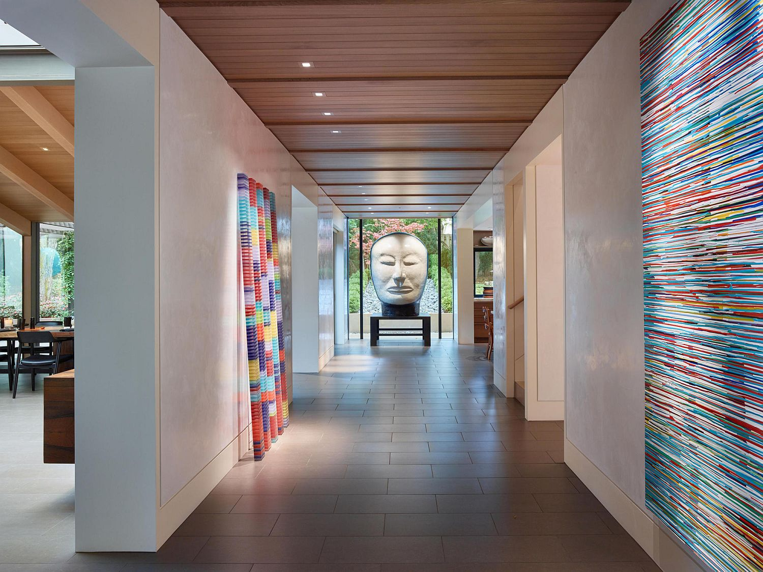 Light-filled interior of the home with colorful art installations