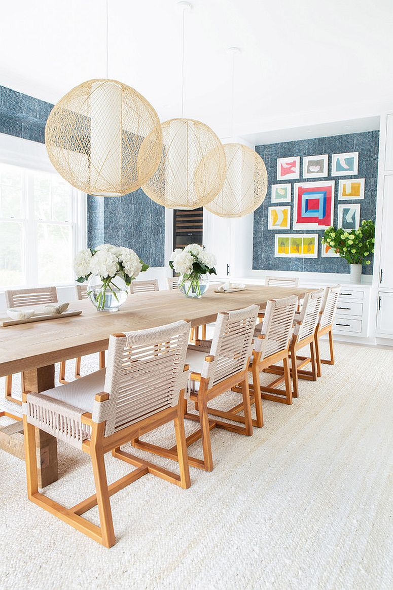 Lighting fixtures steal the show in this beach style dining room