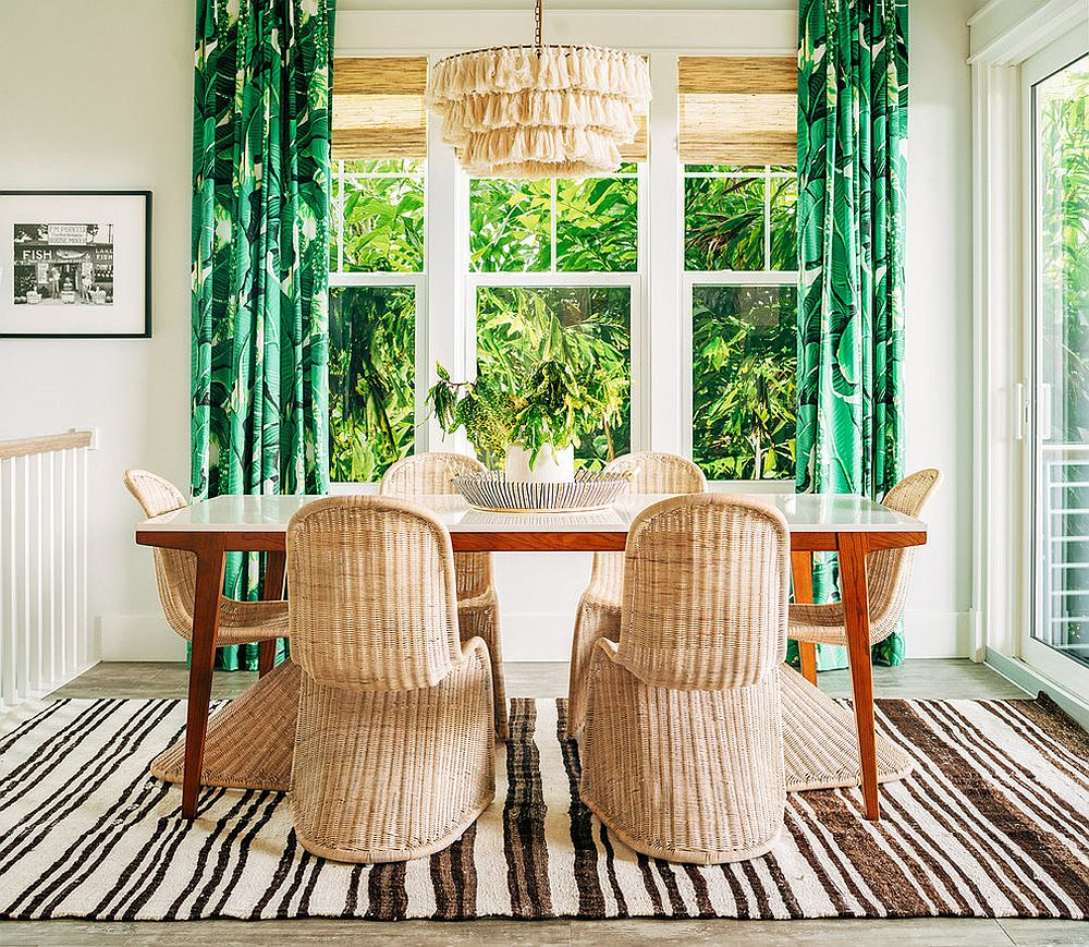 Lovely green curtains add color and class to the neutral hued dining room