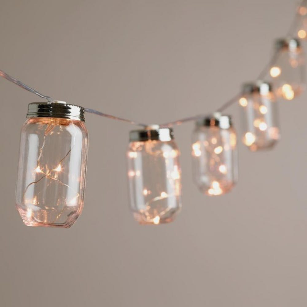 Mason jars coupled with string lights for a cool holiday lighting idea