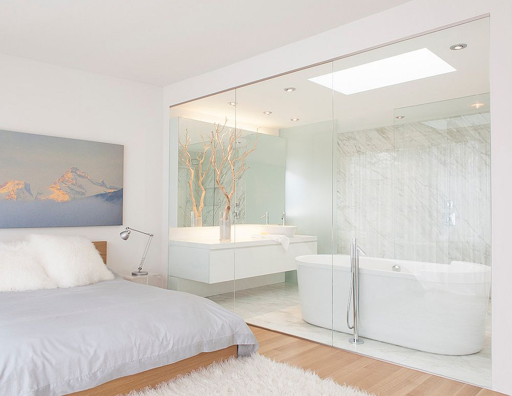 Master bathroom embraces the white and wood look of the bedroom