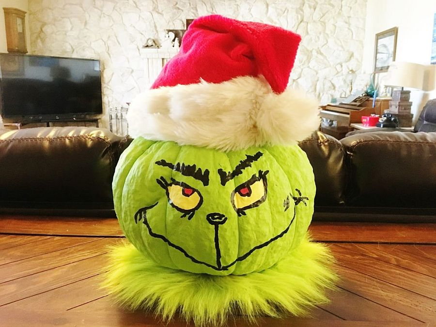 Mean-looking grinch pumpkin DIY with Christmas hat